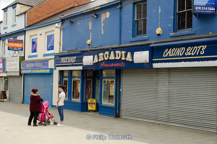 Amusement arcade, casino and closed shops in Seaham high street, County Durham. Formerly known as Seaham Harbour, the town served as a port for the export of coal until the last local pit closed in 1992.  The harbour now functions at a much reduced level, importing coal from Eastern Europe and elsewhere.