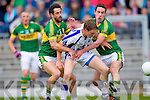 Paul Galvin and Anthony Maher tackle Waterford's Tommy Prendergast last Saturday in Fitzgerald Stadium for the Munster GAA football championship