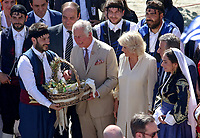 Pictured: Prince Charles and wife the Duchess of Cornwall receive a gift at the village of Arhanes on the island of Crete, Greece. Friday 11 May 2018 <br /> Re: HRH Prnce Charles and his wife the Duchess of Cornwall visit thevillage of Arhanes near Heraklion, Greece.