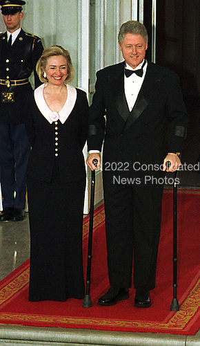 United States President Bill Clinton and first lady Hillary Rodham Clinton await the arrival of Prime Minister and Mrs. Jean Chretien of Canada for an Official White House Dinner on the North Portico of the White House in Washington, D.C. on April 8, 1997..Credit: Ron Sachs / CNP