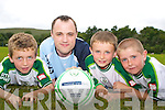 FAI CAMP: Bob Hennessy, regional support manager National Irish Bank, pictured with Taylor Devine, Brian Twomey and Donal O'Sullivan at the National Irish Bank FAI Summer Soccer School held at the Inter Kenmare soccer pitch last week.   Copyright Kerry's Eye 2008