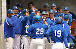 The Western Nevada College Wildcats greet Beau Day after he hit a solo home run during Friday's college baseball game against College of Eastern Utah on April 15, 2011, in Carson City, Nev. .Photo by Cathleen Allison