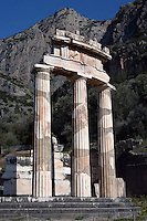 DELPHI, GREECE - APRIL 11 : A low angle view of the Tholos with the Mount Parnassus in the background, on April 11, 2007 in the Sanctuary of Athena Pronaia, Delphi, Greece. Circular marble structure, the Tholos is in the Doric order and was built at the beginning of the 4th century BC. Only 3 of the 20 columns that were surrounding the cella walls have been restored with the epistyle, triglyphs, metopes and part of the gutter of the roof. (Photo by Manuel Cohen)
