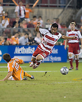 FC Dallas forward Carlos Ruiz jumps over the slide tackle from Houston Dynamo midfielder Riuchard Mulrooney during the second leg of the Western Conference Semifinal Series at Robertson Stadium in Houston, TX on November 2, 2007