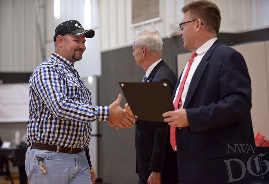 NWA Democrat-Gazette/BEN GOFF @NWABENGOFF<br /> Gary Parsons (from left), an Adult Drug Court graduate from Springdale, shakes hands with U.S. Congressman Steve Womack and circuit judge Thomas Smith as he recieves his certificate Friday, May 12, 2017, during the Benton County Adult Drug Court and Veterans Treatment Court graduation at Bentonville Church of Christ.