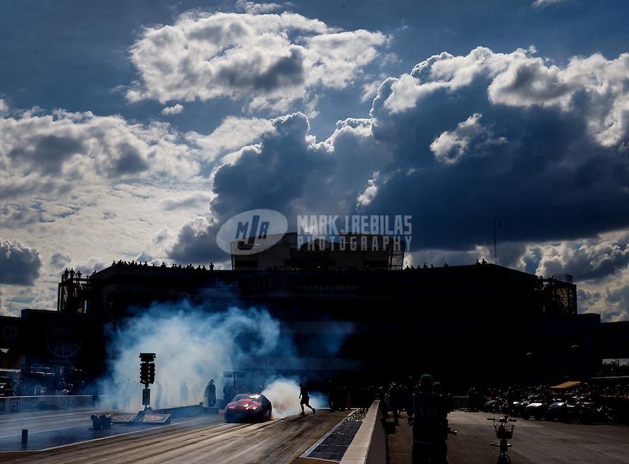 Sep 18, 2016; Concord, NC, USA; NHRA pro stock driver Greg Anderson does a burnout during the Carolina Nationals at zMax Dragway. Mandatory Credit: Mark J. Rebilas-USA TODAY Sports