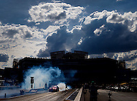 Sep 18, 2016; Concord, NC, USA; NHRA pro stock driver Greg Anderson does a burnout during the Carolina Nationals at zMax Dragway. Mandatory Credit: Mark J. Rebilas-USA TODAY Sports