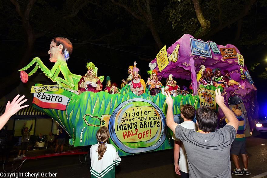 The Krewe D'Etat parade and its satirical float The Preying Mantis rolls in New Orleans on Friday, Feb. 24, 2017. (AFP/CHERYL GERBER)