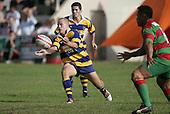 B. Maloney shifts the ball on. Counties Manukau Premier Club Rugby, Waiuku vs Patumahoe played at Rugby Park, Waiuku on the 8th of April 2006. Waiuku won 18 - 15
