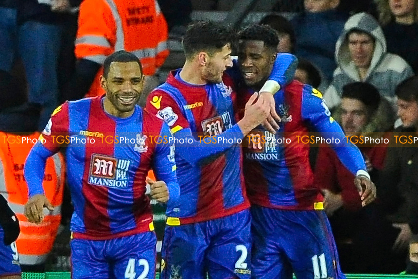 Joel Ward of Crystal Palace middle congratulates Wilfried Zaha of Crystal Palace after scoring the second goalduring Southampton vs Crystal Palace at St Mary's Stadium