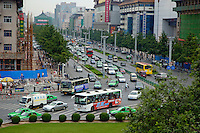 Road traffic on a busy avenue near the South Gate pavilion, Xi'an, Shaanxi, China.