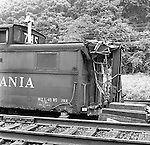 Corliss PA - View of a damaged caboose at an accident site near the train station at Corliss Pennsylvania.  The assignment was for the PA Railroad due to a train derailment near the station - 1964.  Brady Stewart Studio was a contract photography studio for the railroad from 1955 through 1965.
