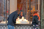 MANHATTAN - FEB 28: Cartier Jewelers Window with Man, seen from behind, window shopping rings at Bridal Collection area outside store on 5th Avenue of Manhattan on February 28, 2010, NYC, USA. Focus on window; Cartier Name at left of window.