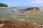 Ocean, granite boulders,  sandy tropical beach at Pasikudah Bay, Eastern Province, Sri Lanka, Asia