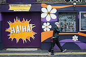 Comedy Cafe in Shoreditch, London, a run-down commercial district  also known as Silicon Roundabout, which is undergoing gentrification as it becomes a centre for web-based companies and IT start-ups.