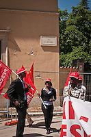 Operai immigrati durante lo Sciopero Nazionale della CGIL, in Abruzzo il corteo della protesta si è svolta nella zona rossa della città de L'Aquila ad un anno dal terremoto. 25/06/2010 Photo: Adamo Di Loreto/BuenaVista*Photo