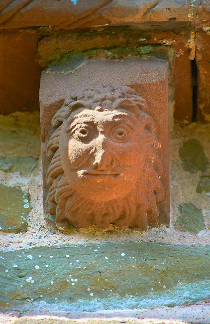 Norman Romanesque exterior corbel no 14 - sculpture of head, half man half lion. The Norman Romanesque Church of St Mary and St David, Kilpeck Herefordshire, England. Built around 1140