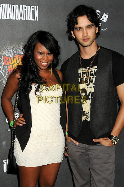 """BRANDEE TUCKER & MICHAEL STEGER.""""Guitar Hero: Warriors of Rock"""" Launch Party held at Paramount Studios, Hollywood, California, USA..September 27th, 2010.half length white dress waistcoat hand on hip married husband wife black brown necklace stubble facial hair .CAP/ADM/BP.©Byron Purvis/AdMedia/Capital Pictures."""
