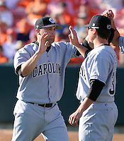 University of South Carolina pitcher Curtis Johnson (24)  is congratulated after a scoreless inning in a game between the Clemson Tigers and USC Gamecocks on March 2, 2008, at Doug Kingsmore Stadium in Clemson, S.C. Photo by: Tom Priddy/Four Seam Images
