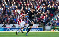 Nemanja Matic of Man Utd hits the ball past Jese of Stoke City during the Premier League match between Stoke City and Manchester United at the Britannia Stadium, Stoke-on-Trent, England on 9 September 2017. Photo by Andy Rowland.