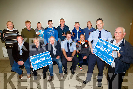 Kilmoyley New Text Alert launched at Kilmoyley Community Centre on Thursday. Pictured Front Garda Garda Mark Cushen and Patrick Griffin, Chairman, Tony Flaherty, Mike McCarthy, Sean McGrath, Garda Enda McInerney, Micheal Ringer, Jim Costello, Gerard Collins, Anthony Nolan, DJ Flaherty, Aidan Dineen, Phil Condon and Mike Curran