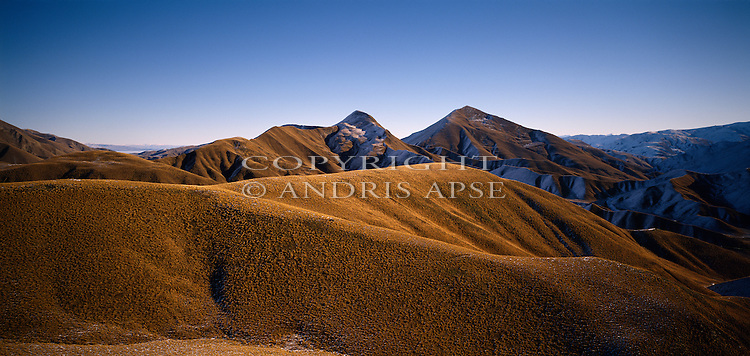 Aerial view of tussock covered hills at Lindis Pass. Otago Region. New Zealand.