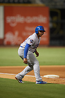 Tennessee Smokies first baseman Yasiel Balaguert (12) leads off third base during a game against the Birmingham Barons on August 16, 2018 at Regions FIeld in Birmingham, Alabama.  Tennessee defeated Birmingham 11-1.  (Mike Janes/Four Seam Images)