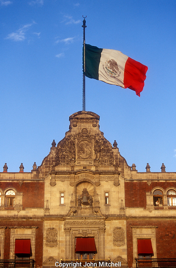 Mexican flag flying above the National Palace or Palacio Nacional on the Zocalo in Mexico City