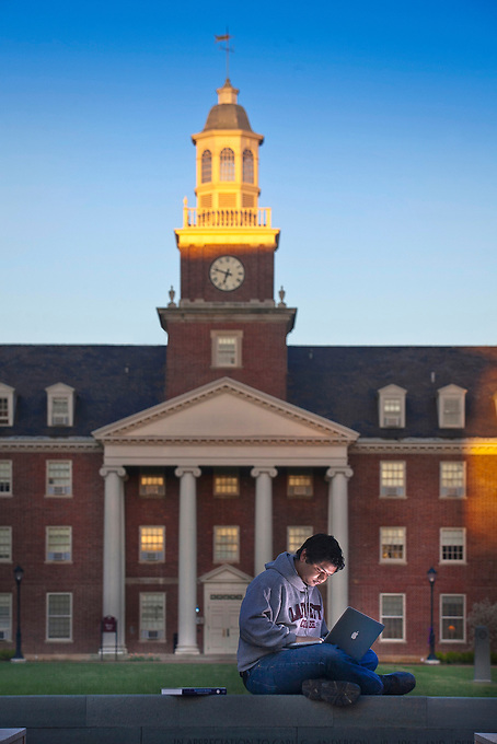 Rijan Maharjan '14 mechanical engineering major sits outside of Watson Hall as the sun rises....chuck zovko / Zovko Photographic  llc.April 5, 2012