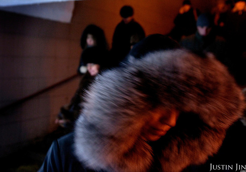 People in fur walk into a tunnel near the Oktyabrskaya metro station. .The Moscow Metro, which spans almost the entire Russian capital, is the world's second most heavily used metro system after the Tokyo's twin subway. Opened in 1935, it is well known for the ornate design of many of its stations, which contain outstanding examples of socialist realist art.