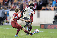 Houston, TX - Friday December 9, 2016: Scott DeVoss (5) of the Denver Pioneers clears the ball from Ema Twumasi (22) of the Wake Forest Demon Deacons  at the NCAA Men's Soccer Semifinals at BBVA Compass Stadium.