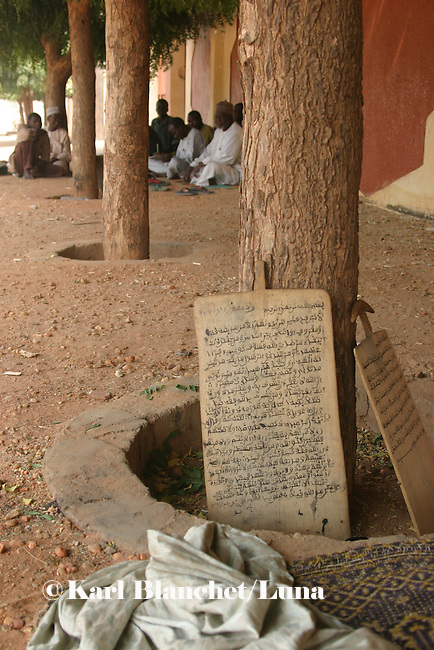 Wooden boards with coranic versets displayed outside the house of the marabout in Maradi, Niger. In Niger, coranic schools still exist and are very traditional. Talibe, pupils, even go and beg for money and food in the afternoon in order to pay the marabout.