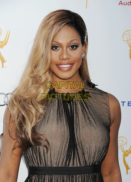 WEST HOLLYWOOD, CA- AUGUST 23: Actress Laverne Cox arrives at the Television Academy's 66th Emmy Awards Performance Nominee Reception at the Pacific Design Center on Saturday, Aug. 23, 2014, in West Hollywood, California.<br /> CAP/ROT/TM<br /> &copy;Tony Michaels/Roth Stock/Capital Pictures