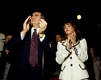 "Montreal (Qc) CANADA - File Photo - Jan 1996 -<br /> Lucien Bouchard,  Leader Parti Quebecois (from Jan 29, 1996 to March 2, 2001). seen in a file photo with wife Audrey Best.<br /> <br /> After the Yes side lost the 1995 referendum, Parizeau resigned as Quebec premier. Bouchard resigned his seat in Parliament in 1996, and became the leader of the Parti Qu»b»cois and premier of Quebec.<br /> <br /> On the matter of sovereignty, while in office, he stated that no new referendum would be held, at least for the time being. A main concern of the Bouchard government, considered part of the necessary conditions gagnantes (""winning conditions"" for the feasibility of a new referendum on sovereignty), was economic recovery through the achievement of ""zero deficit"". Long-term Keynesian policies resulting from the ""Quebec model"", developed by both PQ governments in the past and the previous Liberal government had left a substantial deficit in the provincial budget.<br /> <br /> Bouchard retired from politics in 2001, and was replaced as Quebec premier by Bernard Landry."