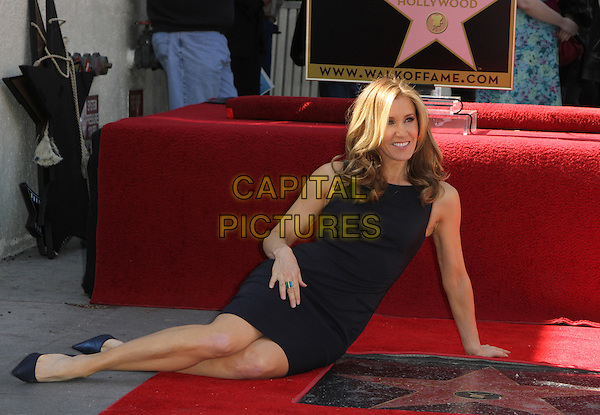 Felictiy Huffman.Felictiy Huffman And William H. Macy Hollywood Walk Of Fame Induction Ceremony Held At On the Walk of Fame, Hollywood, California, USA.  .March 7th, 2012.full length black dress sitting.CAP/ADM/KB.©Kevan Brooks/AdMedia/Capital Pictures.
