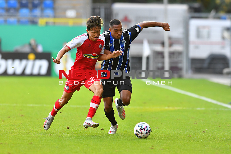 13.09.2020, Carl-Benz-Stadion, Mannheim, GER, DFB-Pokal, 1. Runde, SV Waldhof Mannheim vs. SC Freiburg, <br /> <br /> DFL REGULATIONS PROHIBIT ANY USE OF PHOTOGRAPHS AS IMAGE SEQUENCES AND/OR QUASI-VIDEO.<br /> <br /> im Bild: Woo-yeong Jeong (SC Freiburg #29) gegen Anton Donkor (SV Waldhof Mannheim #19)<br /> <br /> Foto © nordphoto / Fabisch