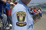 Niagara Falls, Ontario, Canada - 01 August 2006---Emblem on the upper arm of a provincial offences officer of the Niagara Parks Police, supervising tourists / visitors  lining up for a cruise on the Niagara River---people, tourism---Photo: © HorstWagner.eu