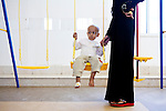 A young cancer patient plays on a swingset at the new Basrah Children's Hospital on Saturday, October 23, 2010 in Basrah, Iraq.