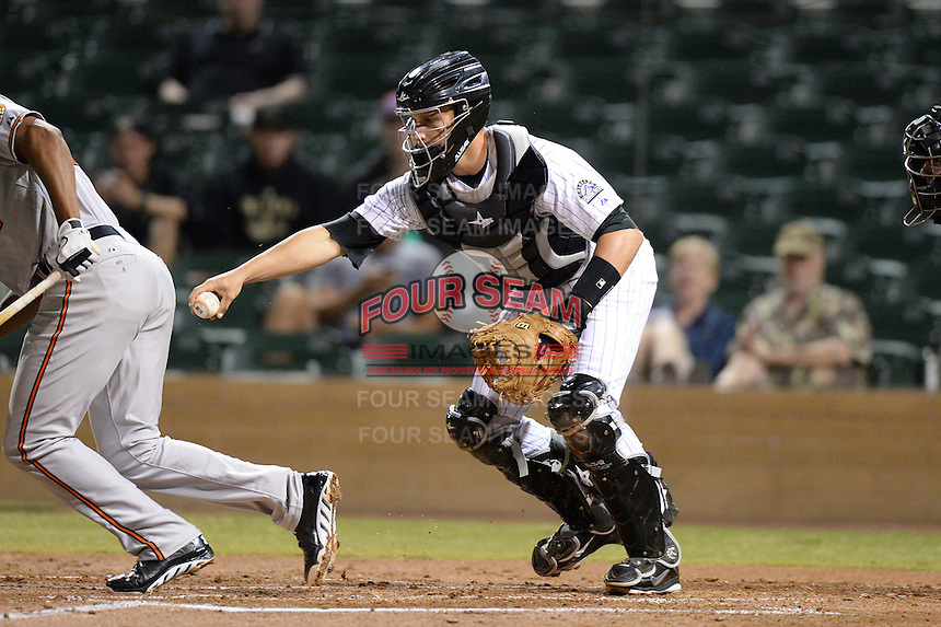 Salt River Rafters catcher Dustin Garneau (27), of the Colorado Rockies organization, during an Arizona Fall League game against the Surprise Saguaros on October 15, 2013 at Salt River Fields at Talking Stick in Scottsdale, Arizona.  Surprise defeated Salt River 9-2.  (Mike Janes/Four Seam Images)