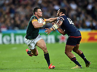 Jesse Kriel of South Africa looks to fend Andrew Suniula of the USA. Rugby World Cup Pool B match between South Africa and the USA on October 7, 2015 at The Stadium, Queen Elizabeth Olympic Park in London, England. Photo by: Patrick Khachfe / Onside Images
