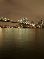 AVAILABLE FOR LICENSING FROM GETTY IMAGES. Please go to www.gettyimages.com and search for image # 129908295.<br /> <br /> The Manhattan Bridge, the DUMBO neighborhood of Brooklyn and the East River Viewed from the East River Esplanade in Lower Manhattan at Night, New York City, New York State, USA