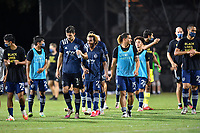LAKE BUENA VISTA, FL - JULY 26: Gianluca Busio of Sporting KC and teammates towards the goal happy following the shootout during a game between Vancouver Whitecaps and Sporting Kansas City at ESPN Wide World of Sports on July 26, 2020 in Lake Buena Vista, Florida.