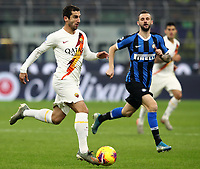 Calcio, Serie A: Inter Milano - AS Roma, Giuseppe Meazza stadium, December 6, 2019.<br /> Roma's Henrikh Mkhitaryan (l) in action with Inter's Marcelo Brozovic (r) during the Italian Serie A football match between Inter and Roma at Giuseppe Meazza (San Siro) stadium, on December 6, 2019.<br /> UPDATE IMAGES PRESS/Isabella Bonotto