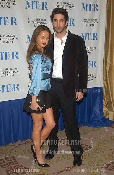 Actor DAVID SCHWIMMER & girlfriend CARLA ALAPONT at the Museum of Television & Radio Gala, in Beverly Hills, honoring the producer of Friends..November 10, 2003