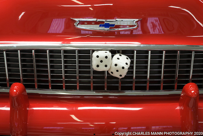 A pair of  fuzzy dice on the grill of a classic 1955 Chevy reminds visitors of another era at the  Route 66 Museum in Santa Rosa, New Mexico
