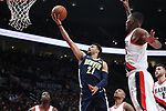 Denver Nuggets guard Jamal Murray (27) shoots under the arms of Portland Trail Blazers forward Maurice Harkless (4) in the first half at Moda Center. <br /> Photo by Jaime Valdez