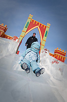 Caterina Miserandino rides an ice slide as her father Dominick looks on at the Quebec Winter Carnival (Carnaval de Quebec) in Quebec city, February 3, 2010. With close to one million participants, it has grown to become the third largest winter celebration in the world.
