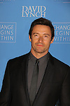 """Actors Hugh Jackman is honored with wife as David Lynch Foundation presents """"Change Begins Within"""" - a benefit and gala celebrating service of veterans and first responders in New York City hosted by David Lynch and Jerry Seinfeld on December 3, 2013 at the Conrad NYC, New York. (Photo by Sue Coflin/Max Photos)"""