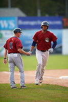 Mahoning Valley Scrappers right fielder Will Benson (7) shakes hands with manager Luke Carlin (11) after hitting a home run during the first game of a doubleheader against the Batavia Muckdogs on September 4, 2017 at Dwyer Stadium in Batavia, New York.  Mahoning Valley defeated Batavia 6-2 to clinch the Pinckney Division Championship.  (Mike Janes/Four Seam Images)
