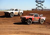 Apr 16, 2011; Surprise, AZ USA; LOORRS driver Wyatt Kirchner (26) races Matt Cook (55) during round 3 at Speedworld Off Road Park. Mandatory Credit: Mark J. Rebilas-.